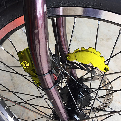 Hard drive magnet mounted to front wheel of bicycle