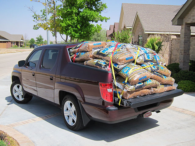 Photo of Honda Ridgeline loaded with 40 bags of mulch